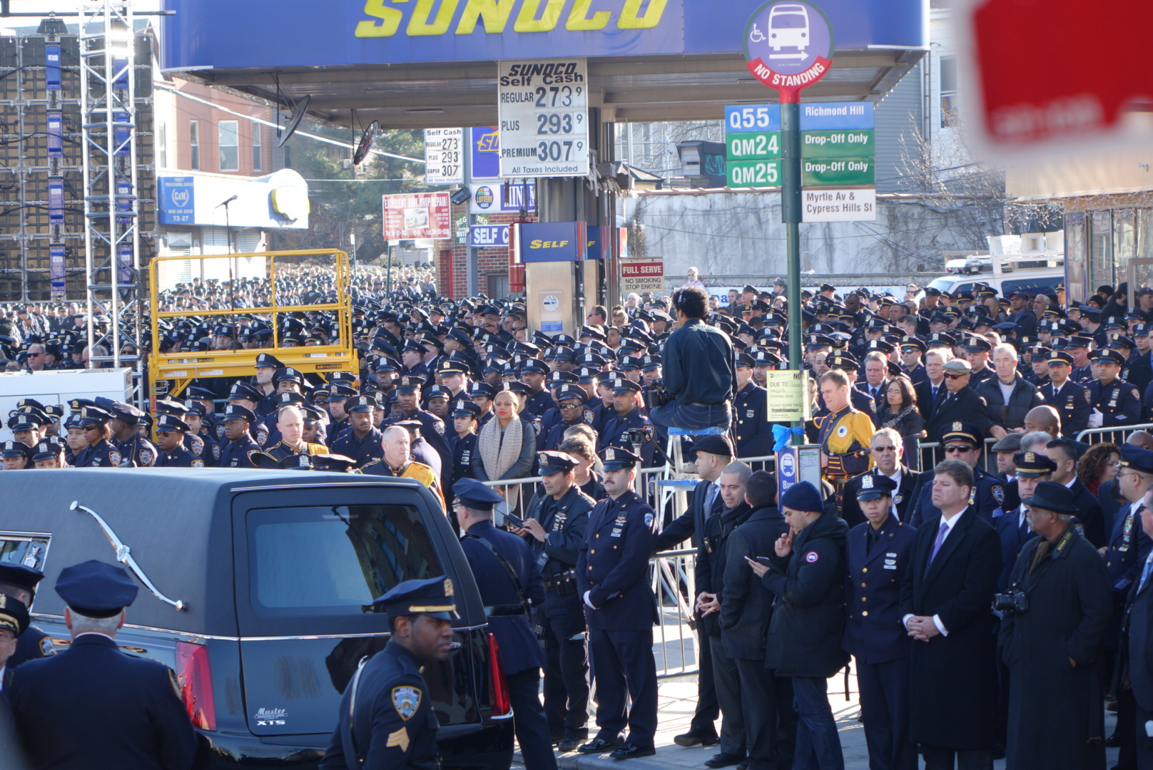 A hearse waited amid a sea of blue as the funeral was underway inside the church.