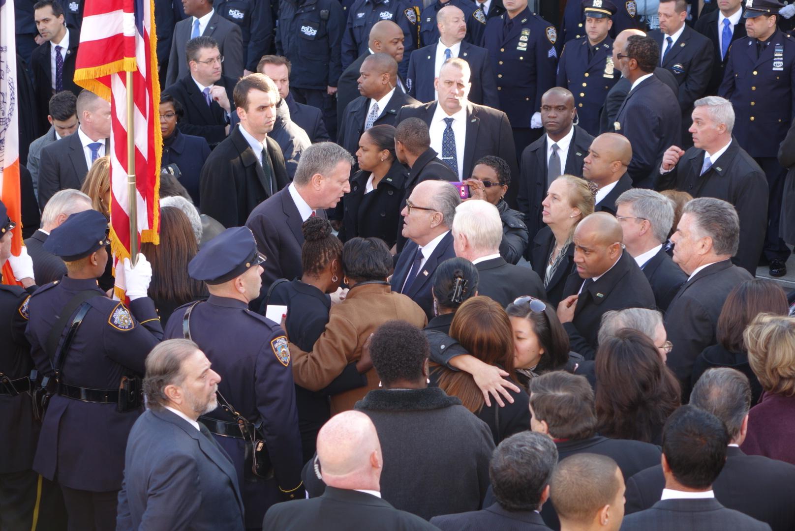 Mayor Bill de Blasio and former Mayor Rudy Giuliani speak briefly following the funeral of Det. Rafael Ramos.