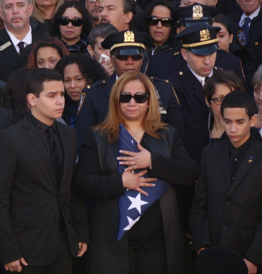 Det. Ramos' wife and sons after receiving the flag which had covered his casket.