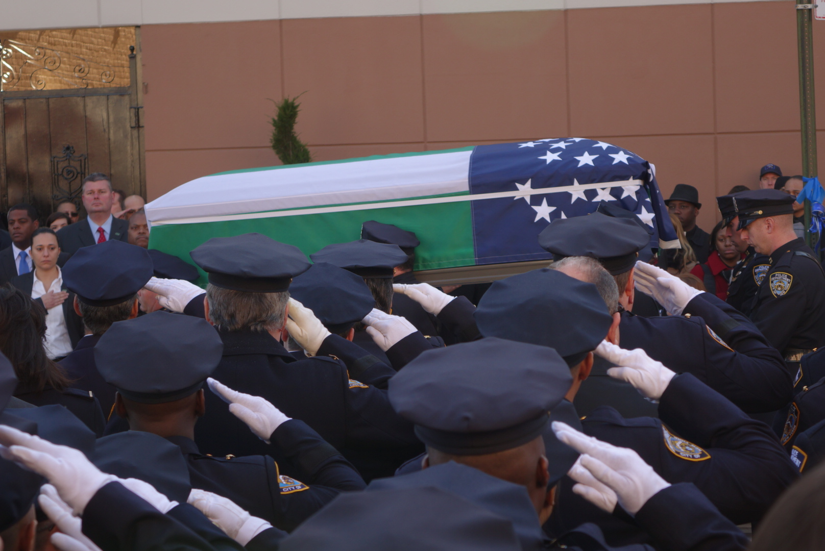 Det. Ramos' casket is carried from the church to a waiting hearse.