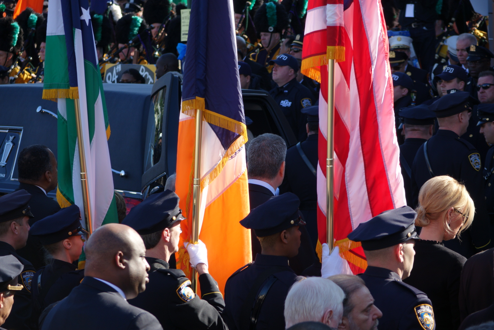 Mayor de Blasio watches as Det. Ramos' casket is place in the hearse.