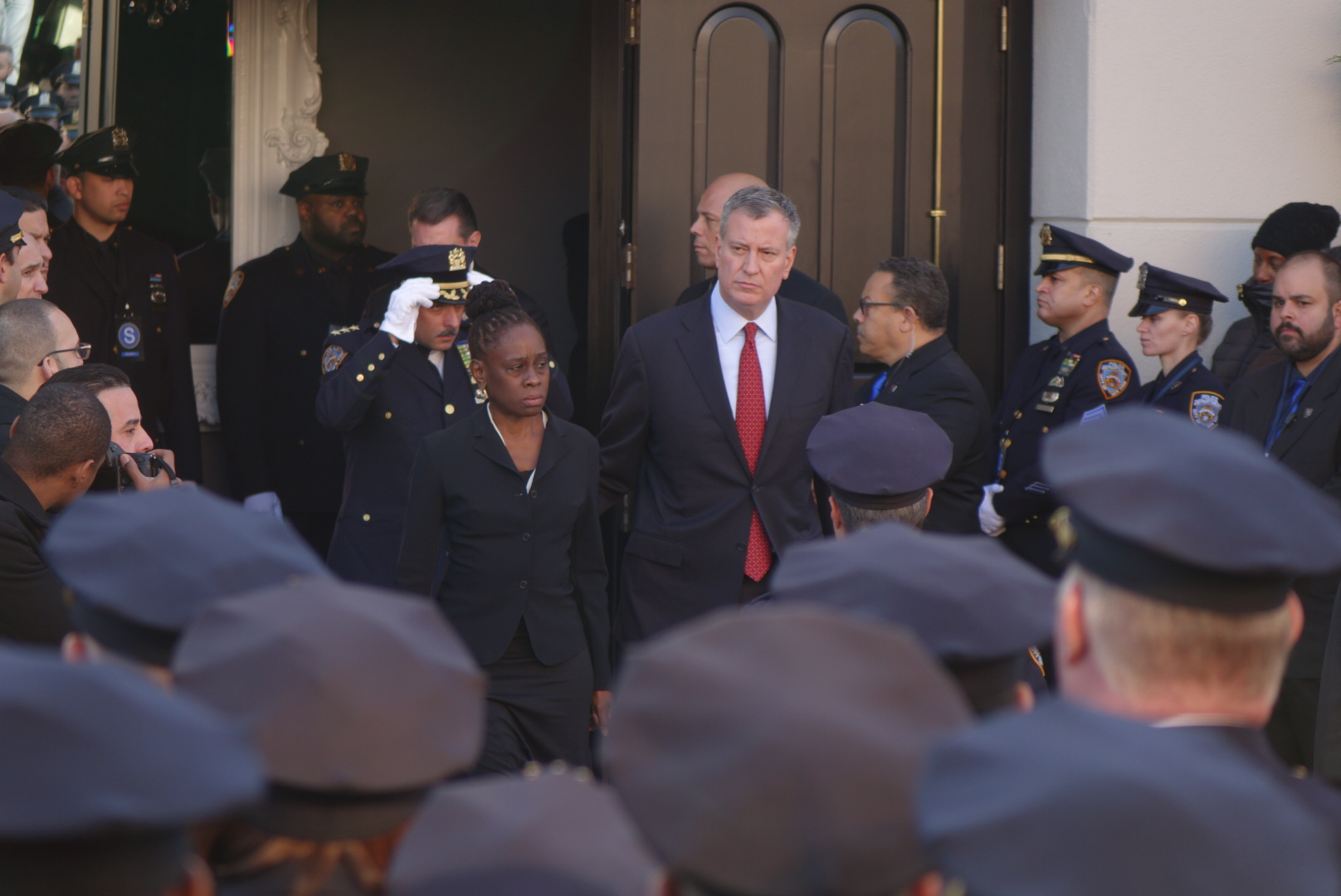 Mayor Bill de Blasio and wife Chirlane McCray leave the church.