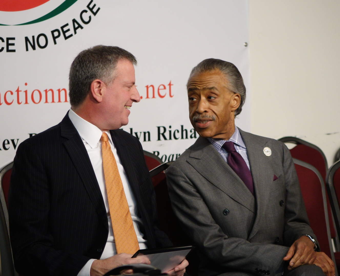 Mayor Bill de Blasio and the Rev. Al Sharpton sit onstage at the beginning of National Action Network's Martin Luther King Day celebration. 1/19/15