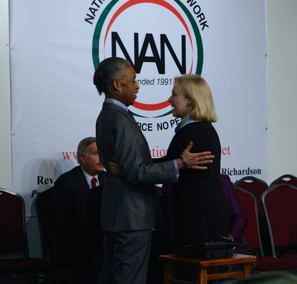 U.S. Senator Kirsten Gillibrand and the Rev. Al Sharpton embrace. 1/19/15