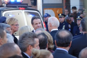 U.S. Attorney Preet Bharara (back of head to camera) looks toward Governor Andrew Cuomo as the funeral for NYPD Detective Rafael Ramos concludes.  12/27/14