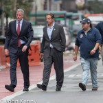 Mayor Bill de Blasio and Governor Andrew Cuomo, along a Cuomo aide, depart the scene of the Chelsea explosion.