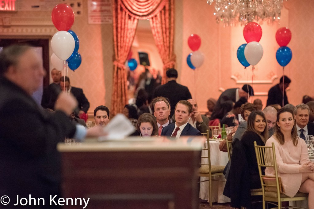 Paul Massey (center) listens as John Catsimatidis speaks at the Bronx GOP dinner. 3/8/17