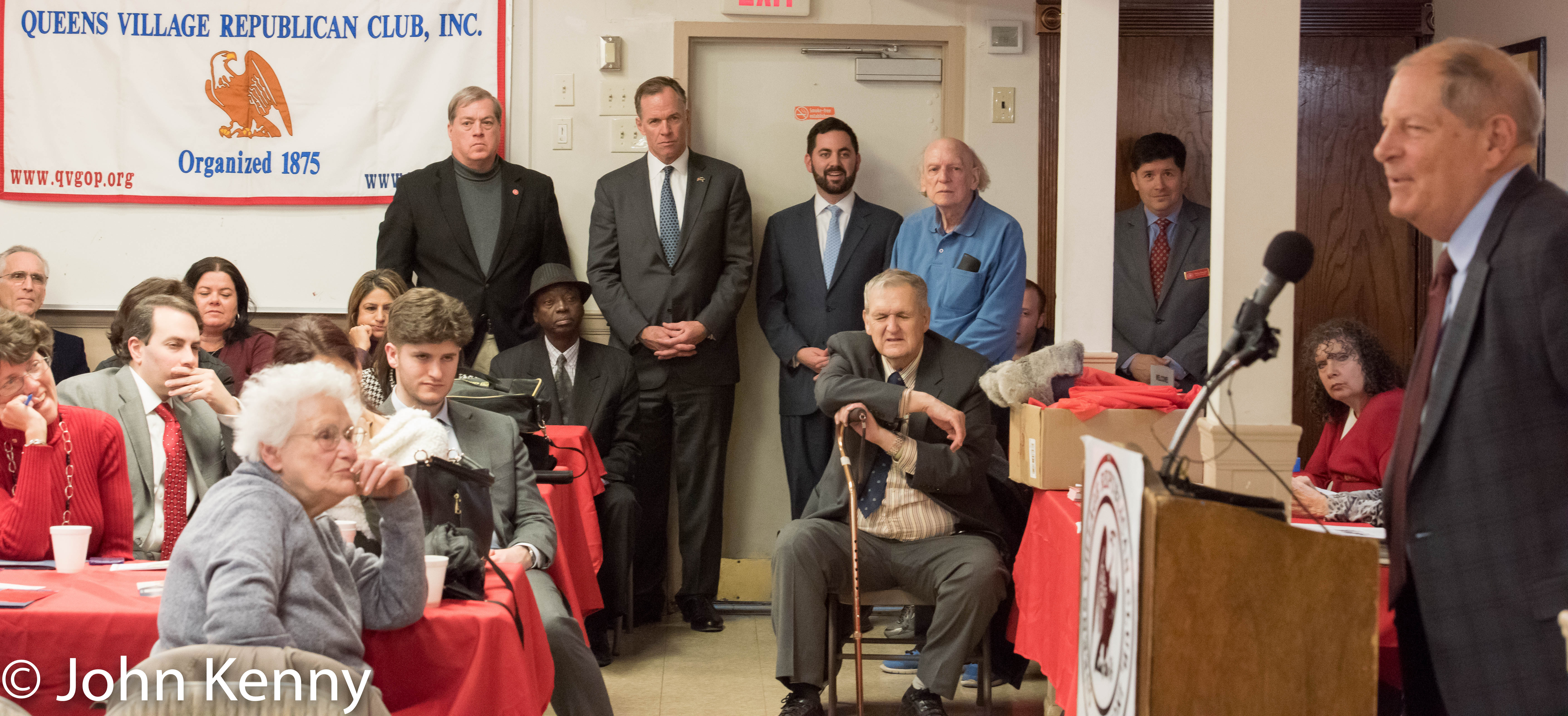 Republican mayoral candidate Paul Massey (standing with hands folded) listens as Queens County Republican Chairman Bob Turner speaks at the Queens Village Republican Club. 3/2/17